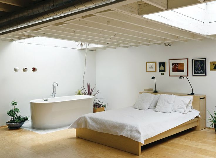 Freestanding bath in bedroom.