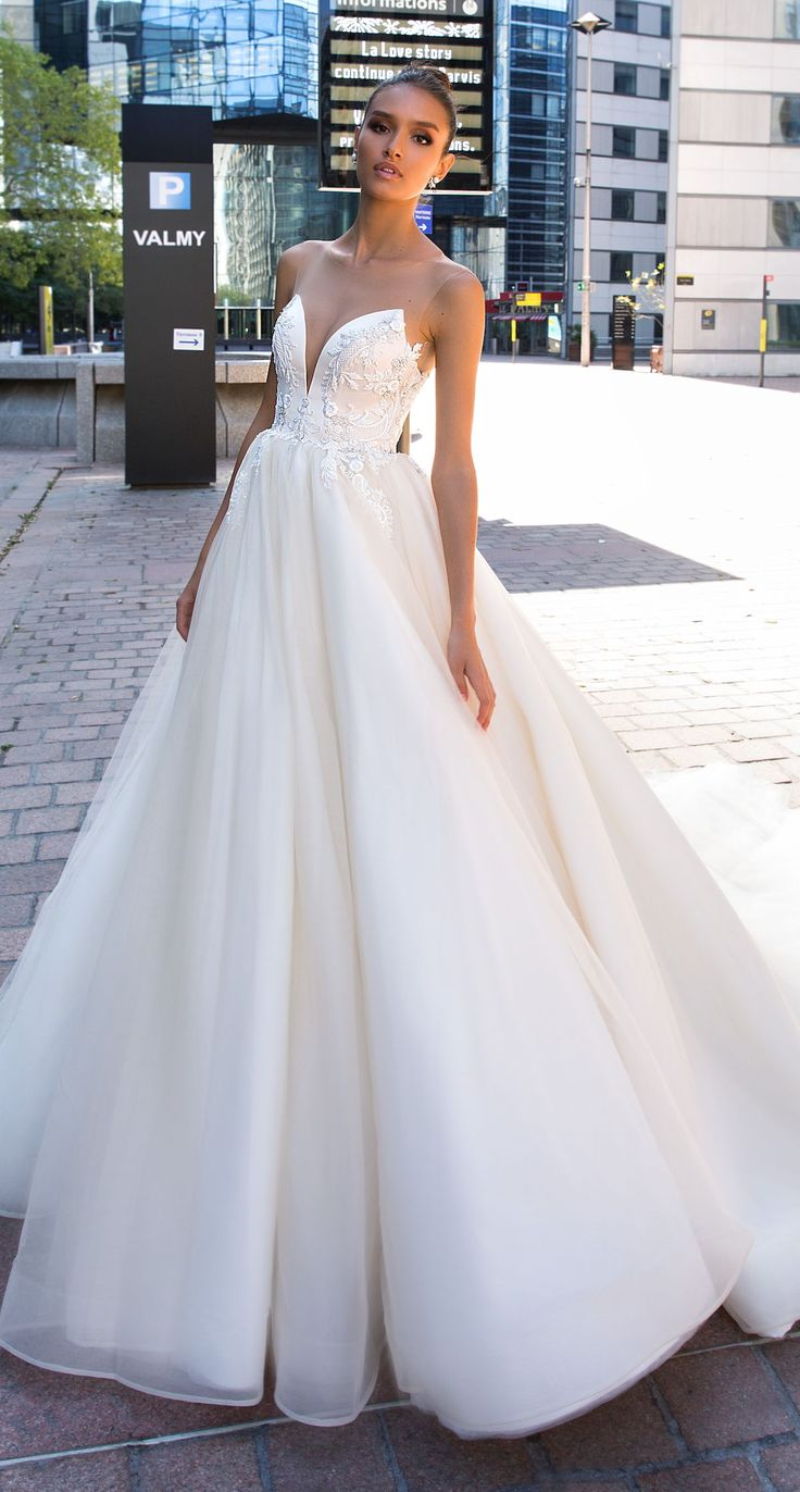 Ball gown wedding dress by Crystal design. strapless illusion princess tulle ski…
