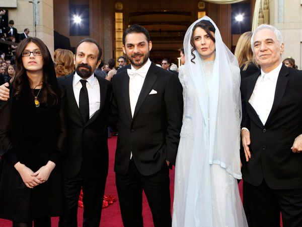 """Asghar Farhadi, (2nd L) director of Iranian film """"A Separation"""", winner of foreign language film, arrives with actors Peyman Maadi (3rd L), Leila Hatami (2nd R) and two unidentified guests at the 84th Academy Awards in Hollywood, California, February 26, 2012."""