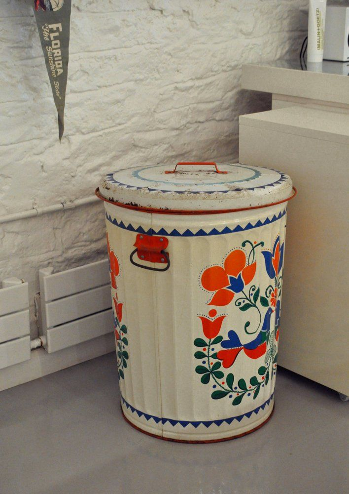 Storage is essential in keeping a space looking put together and clean.  A funky vintage trash can like this or baskets are an inexpensive way to keep out the clutter.