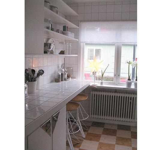 Kitchen with radiator under window--Chez Larsson