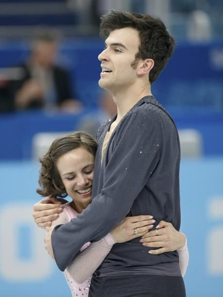 Meagan Duhamel (Lively, Ontario) and Eric Radford (Balmerton, Ontario) of Canada celebrate at the end of their performance during the Team Pairs Short Program at the Sochi 2014 Winter Olympics, February 6, 2014. REUTERS/Lucy Nicholson