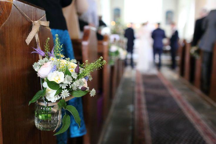 pretty jars of flowers at church in hempstead