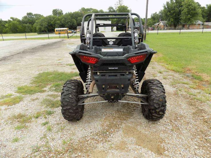 New 2015 Polaris RZR® XP 4 1000 EPS ATVs For Sale in Kansas. 110 hp ProStar® 1000 H.O. EFI engine High flow clutch intake system Exclusive Walker Evans needle shocks Dimensions: - Wheelbase: 117 in. (297.2 cm) Other: - Notes: RZR® Models (Excluding YOUTH) Warning: The Polaris RZR® can be hazardous to operate and is not intended for on-road use. Driver must be at least 16 years old with a valid driver's license to operate. Passengers must be at least 12 years old. Drivers and passengers…