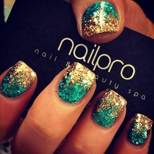 Teal & gold all glitter ombre nails...try it w/black & gold