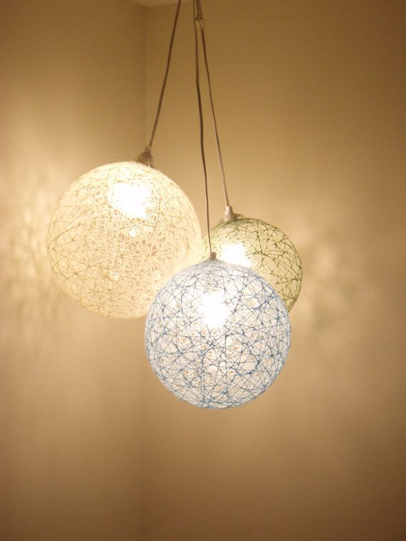 Dye glue different colors. (or use colored twine and glue that dries clear). Dip twine in the glue and wrap around a inflated balloon. Make sure to make a circle of twine where you want the lightbulb to fit through. When glue is dry, pop balloon and use as lampshade