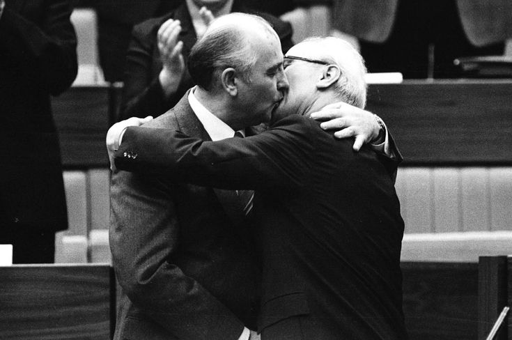 The Soviet leader Mikhail Gorbachev congratulates East German leader Erich Honecker with a fraternal hug and kiss after Honecker's re-election as the head of the Communist Party Congress in East Berlin, on April 21, 1986.