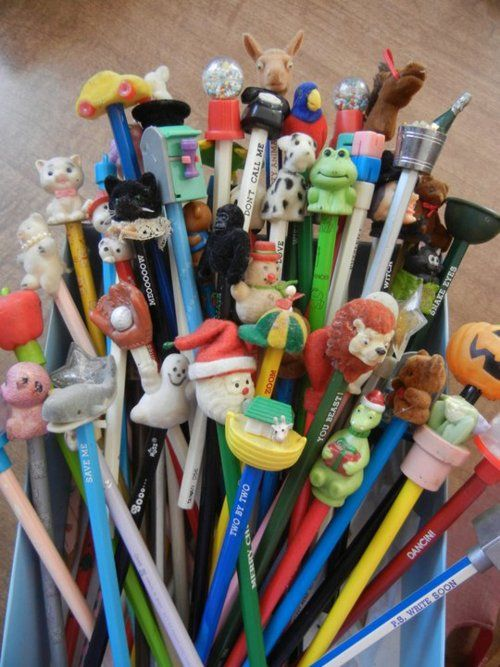 "Pencils with toppers.  My favorite is the ""you're the tops"" pencil that had a heart-shaped topper wearing a top hat."