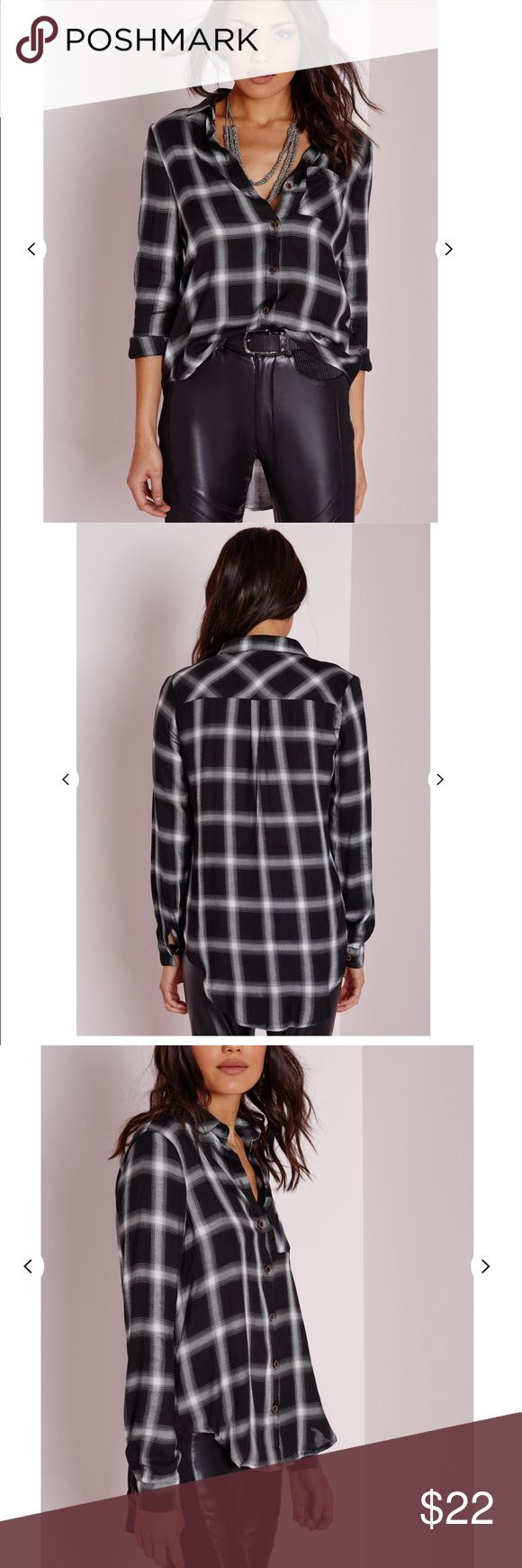 Missguided Black and White Plaid Button Up Shirt Black/grey/white plaid with a front pocket. Wooden buttons. It's a high-low shirt, higher in the front, longer in the back. 100% cotton Missguided Tops Button Down Shirts
