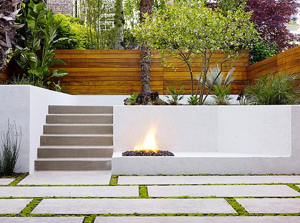 Modern tile in an outdoor space. Liking the moss between stepping stones