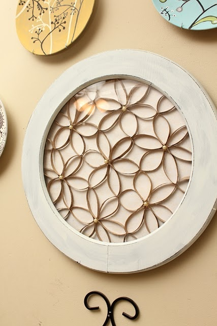 Toilet paper roll flowers with pearls in the center, then frame it.