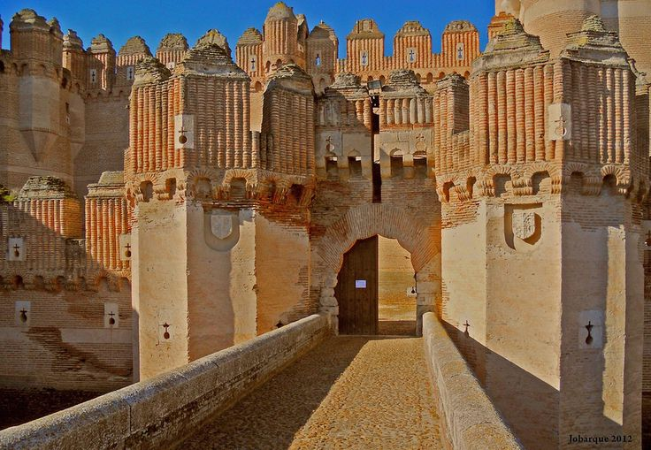 Castillo de Coca, Spain | This castle was built on the site of ancient Cauca, the birthplace of the Roman emperor Theodosius. The castle now serves as a training school for foresters.