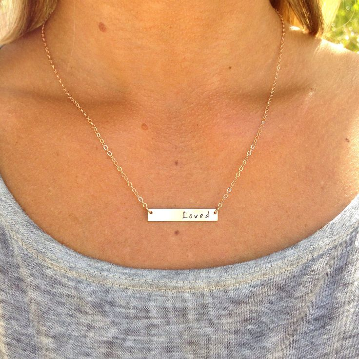 A personal favorite from my Etsy shop https://www.etsy.com/ca/listing/269192275/name-plate-necklace-gold-bar-necklace