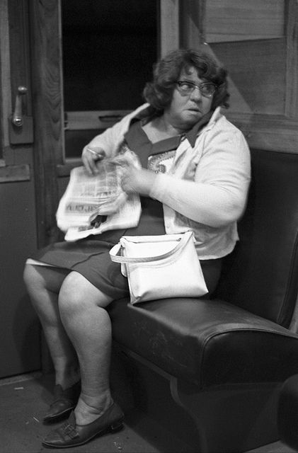 Having a ciggie (Woman on night train, Epping line) 1976 (Melbourne Australia by David Wadelton