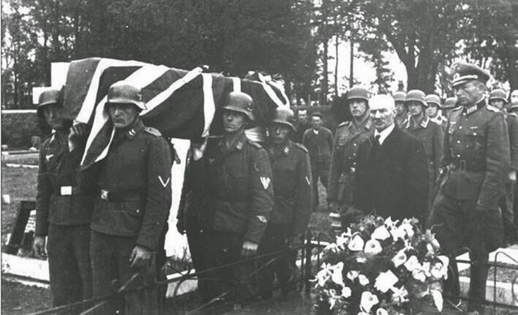 A RAF airman is buried with full military honors by occupying German soldiers, 1943