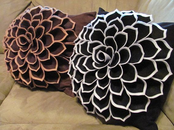 These gorgeous pillow patterns are available to purchase from Sew You Can Too.  I think they'd look great in winter white felt piled up on a...