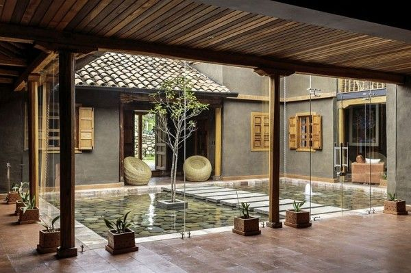 Central courtyard of the home with a reflective pond and walkway