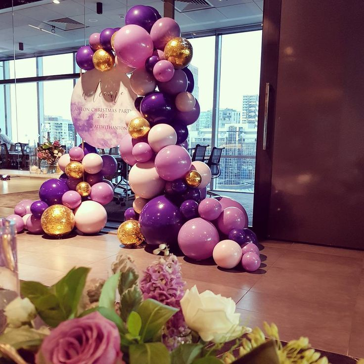 Shivoo Balloons: Organic balloon arch in shades of purple with a touch of gold.