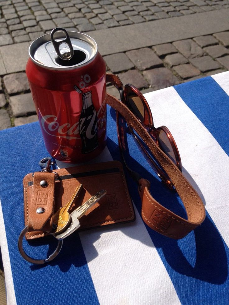 Natural brown accessories.  Wallet 21,5 € Keychain 9 € Strap for glasses 21,5 € Coca-cola 1 €