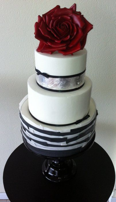Fondant work, silver leaf,  and red sugar rose wedding  cake