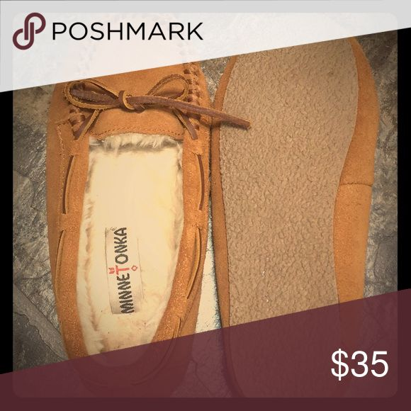 SHEEPSKIN HARDSOLE MOC (WOMEN) EUC Women's Minnetonka Moccasins size 6.5 Warm comfort meet classic style in these gorgeous moccasin slippers.  Soft sheepskin is crafted by hand to create these luxurious indoor-outdoor slippers. The soft sheepskin lining keeps feet warm while wicking away moisture from your skin, keeping you dry and comfortable. With rawhide laces and a sturdy sole, you can easily take these sheepskin slippers outside on the go. Minnetonka Shoes Moccasins