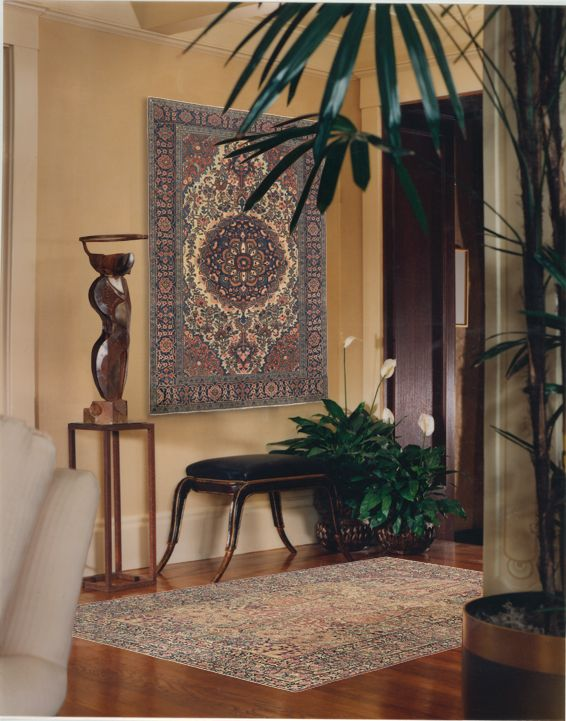 Living Room Rugs A Ferahan antique rug on the wall and a Laver Kirman antique carpet on the floor enhance each other us beauty in this home Rugs from Claremont Rug Company