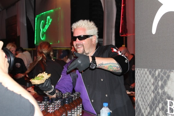 2012 South Beach Wine and Food Festival - Guy Fieri showing off for the cameras.