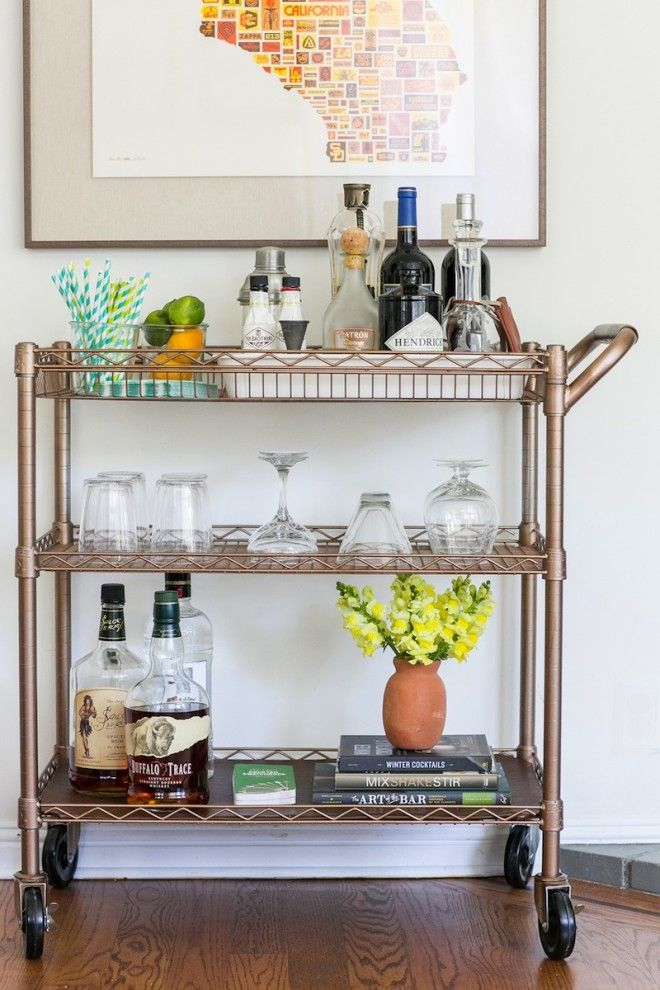 An incredible bar cart DIY!! This beauty started life as a bright chrome utility cart from Sam's Club! Love the practical but pretty styling too.