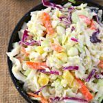 Pineapple Coleslaw – Creamy and tangy coleslaw with pineapple, great as a side or perfect on top of spicy pork or chicken. Coleslaw is one of those things I love. It was where my love for cabbage began. Sadly, creamy slaws aren't really on the docket for me anymore. Mayo or Miracle Whip based slaws do not play nicely. Then Greek yogurt became all the rage and entered my world. Voilá, I have a way to have creaminess again. Depending on what I am making, I might do half non-fat Greek yogurt…