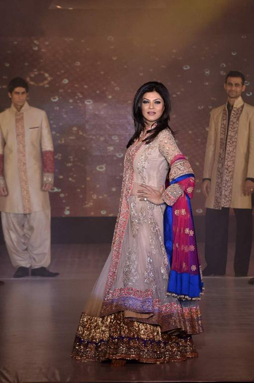 Sushmita Sen modeling an Indian bridal lehnga by Manish Malhotra. Click through for more.