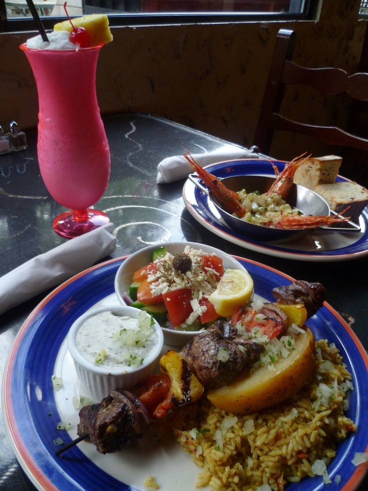Last weekend's Chef's Creations: Flaming Sambuca Prawns Appetizer; spotted prawns sauteed with fennel, garlic & butter, then flambeed with Sambucca.   For Dinner: AAA Angus Beef Kabob with Roma tomatoes, orange & yellow peppers & red onion. Served with rice and potato, Greek salad & tzatziki.