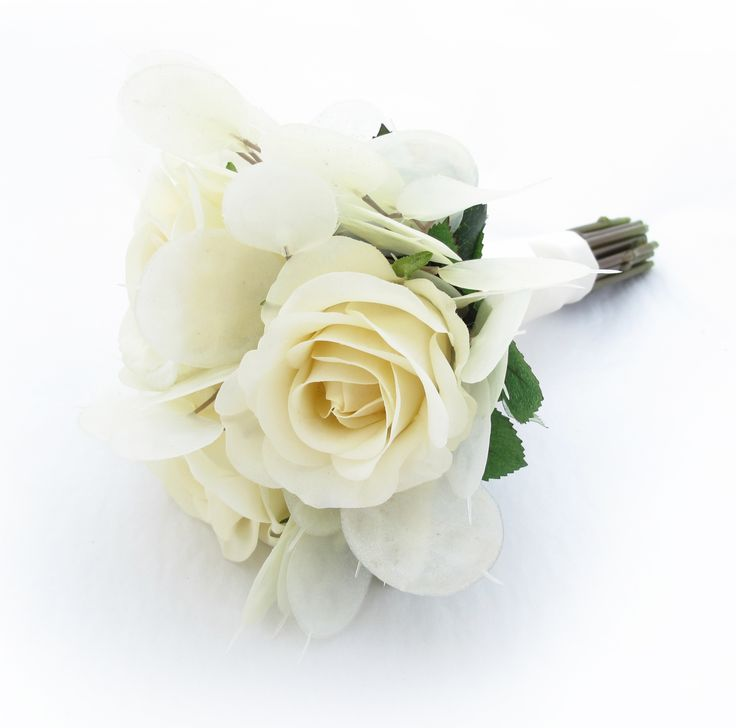 Flowergirl's posy of roses and silver dollars. Find your perfect wedding flowers at www.loveflowers.com.au