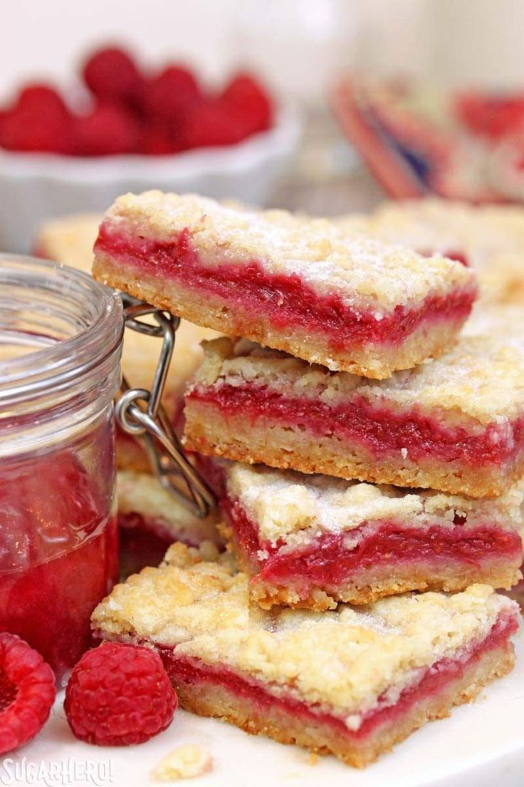 Raspberry Rhubarb Almond Bars - sweet almond bars with a delicously tart raspberry-rhubarb jam inside! | From SugarHero.com