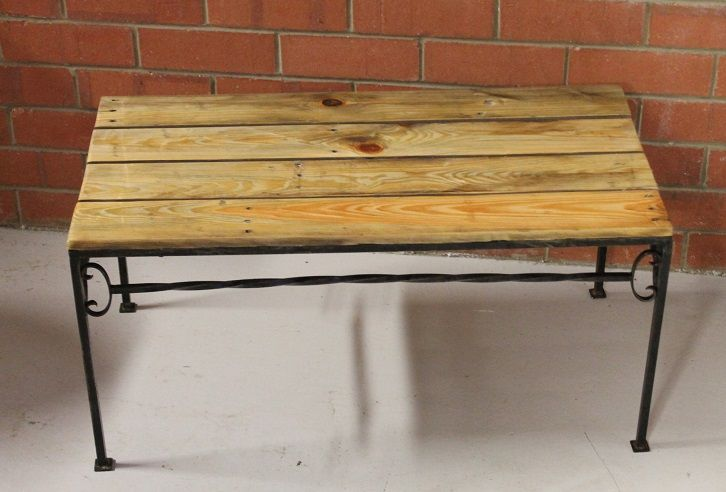 Upcycled Wrought iron table. Raw iron finish with top made from used pallet timber