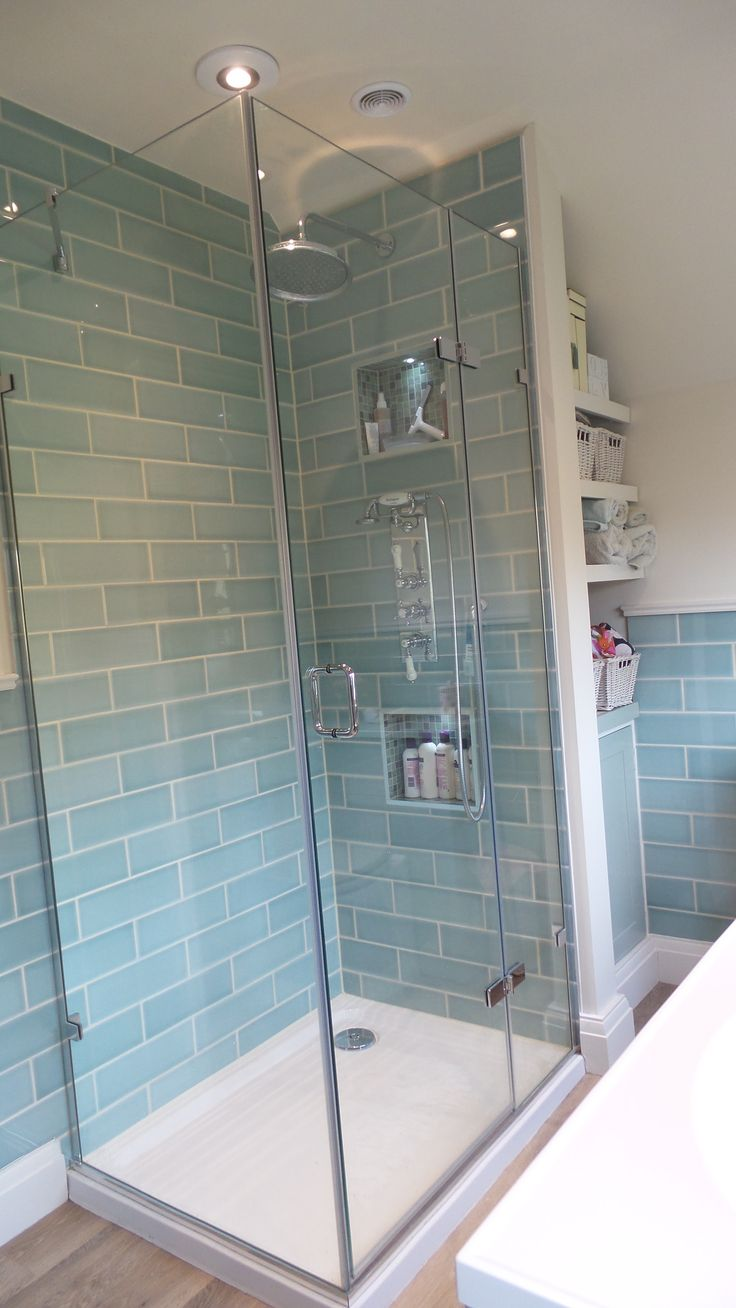 Mistley Agave glass enclosure with tradtional Burlington shower and beautiful Savoy brick tiles.