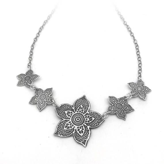 Receiving real flowers is a wonderful feeling, but opening up a jewelry gift box with these eternal silver flowers is even better. You can wear this versatile silver flower pendant necklace with your little black dress or throw it on last minute as an effortless upgrade to a