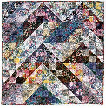 Use my Split Nine Patch quilt pattern to make a strip pieced quilt that can arranged into many different layout variations.