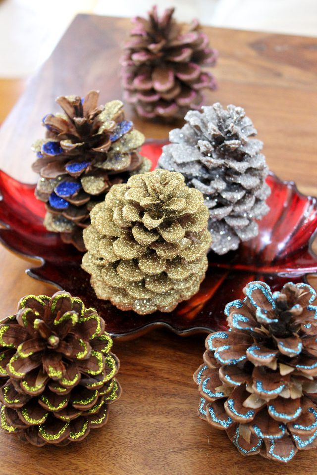 Here are three easy ways to add colorful glitter to pine cones for a festive fall and winter decoration.
