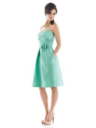 Strapless cocktail dress with sweetheart pleated bodice. Pockets at side seams of full pleated skirt.