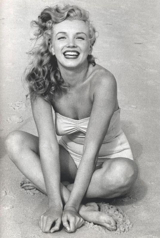 Marilyn Monroe on the beach. Don't you just want that swimsuit?!