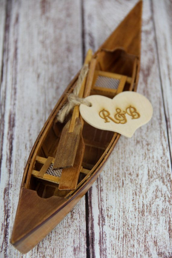Canoe cake topper is perfect for an outdoorsy couple. Cake topper comes with two canoe paddles and a wooden heart that has been laser engraved