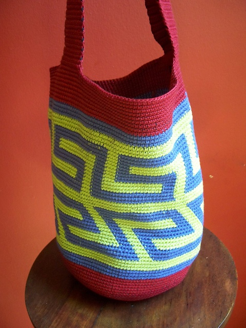 Tapestry crochet - this ravelry user has lots of cool tapestry-like designs