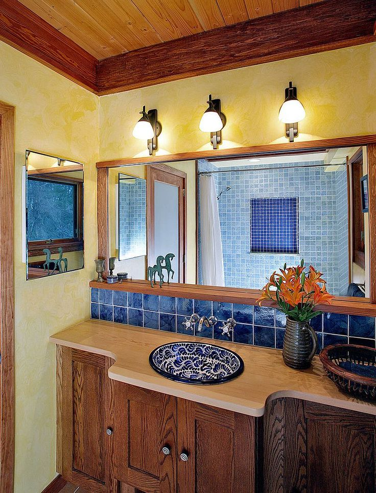 Textured walls in yellow bring warmth to the Mediterranean style bathroom [Design: Abrams Design Build / Photography: Ken Wyner Photography]