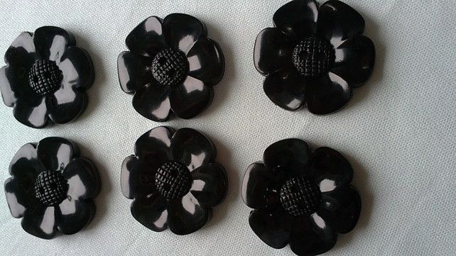 Smaller version of Chunky Shape Flower Button 33mm diameter £3.00