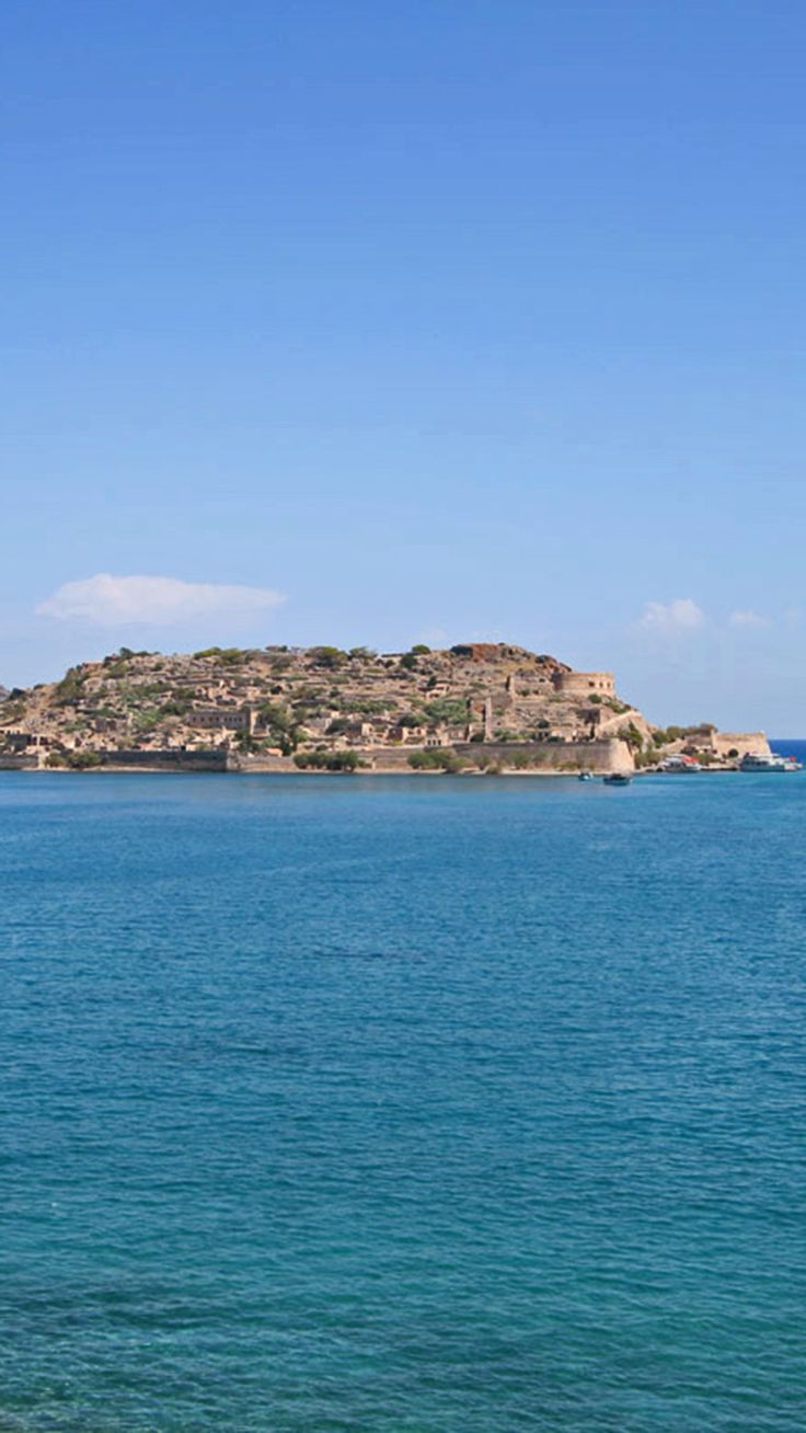 Spinalonga Peninsula viewed from the Mirabello Bay in Elounda #crete #voyage #greece #blue #TheHotelgr #travel #inspiration