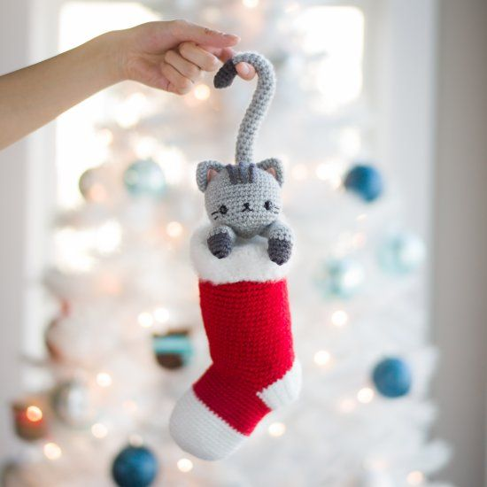 Crochet this adorable Christmas cat named Chester who loves hiding in stockings! Free pattern & step-by-step tutorial available!