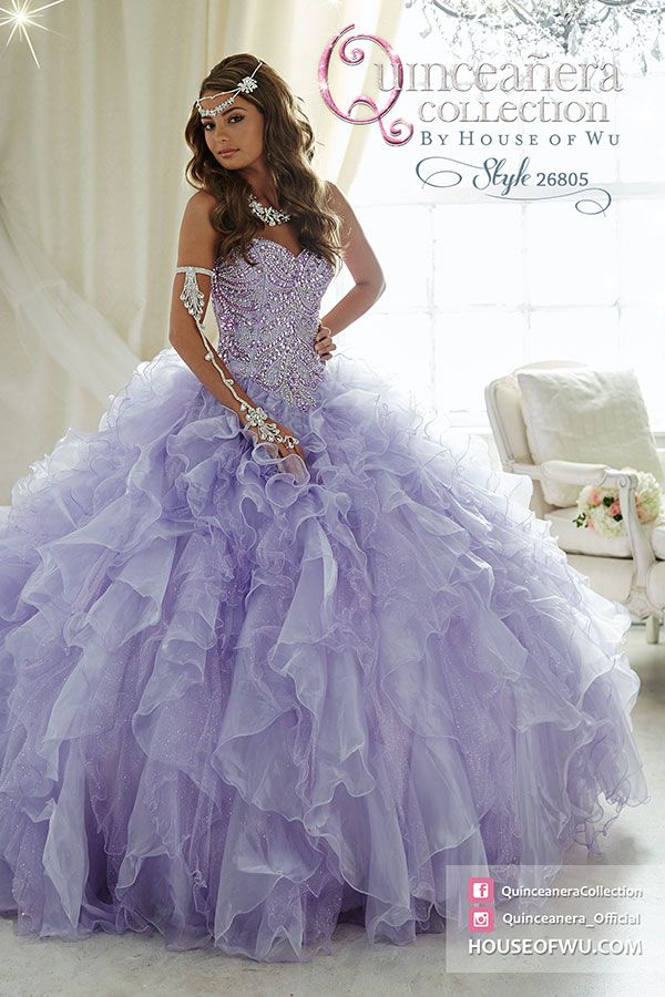 #QuinceaneraCollection-Style 26805 Make an unforgettable entrance in this extravagant quinceañera gown encrusted with beads and flowing with sparkling tulle ruffles. Lace-up back.