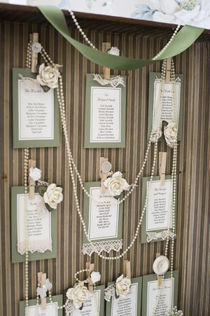 Vintage lace and pearl seating chart. Only pictures instead of seating chart