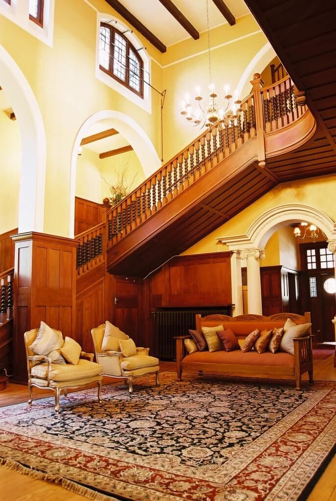 Sophisticated, elegant interiors in a century old Johannesburg mansion with large imposing rooms and impressive architectural detail.