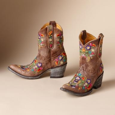 "FULL BLOSSOM BOOTS BY OLD GRINGO -- Kick up your heels or kick back and prop your feet on the front porch railing. Old Gringo's artisanal boots are emblazoned with a freefall of embroidered flowers. Red boot, 1-1/2"" canted heel"